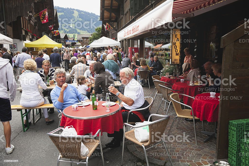 People relaxing at an outdoor cafe, Saanen Brocante royalty-free stock photo