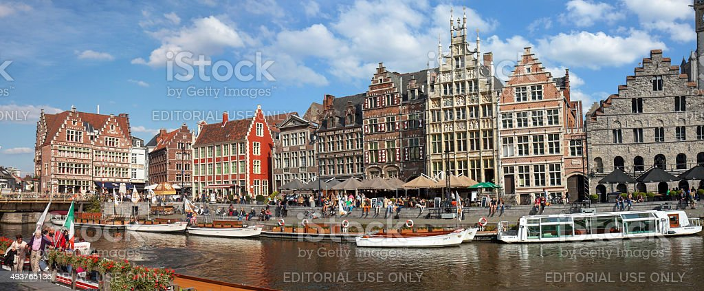 People relaxing at Graslei,  Ghent stock photo