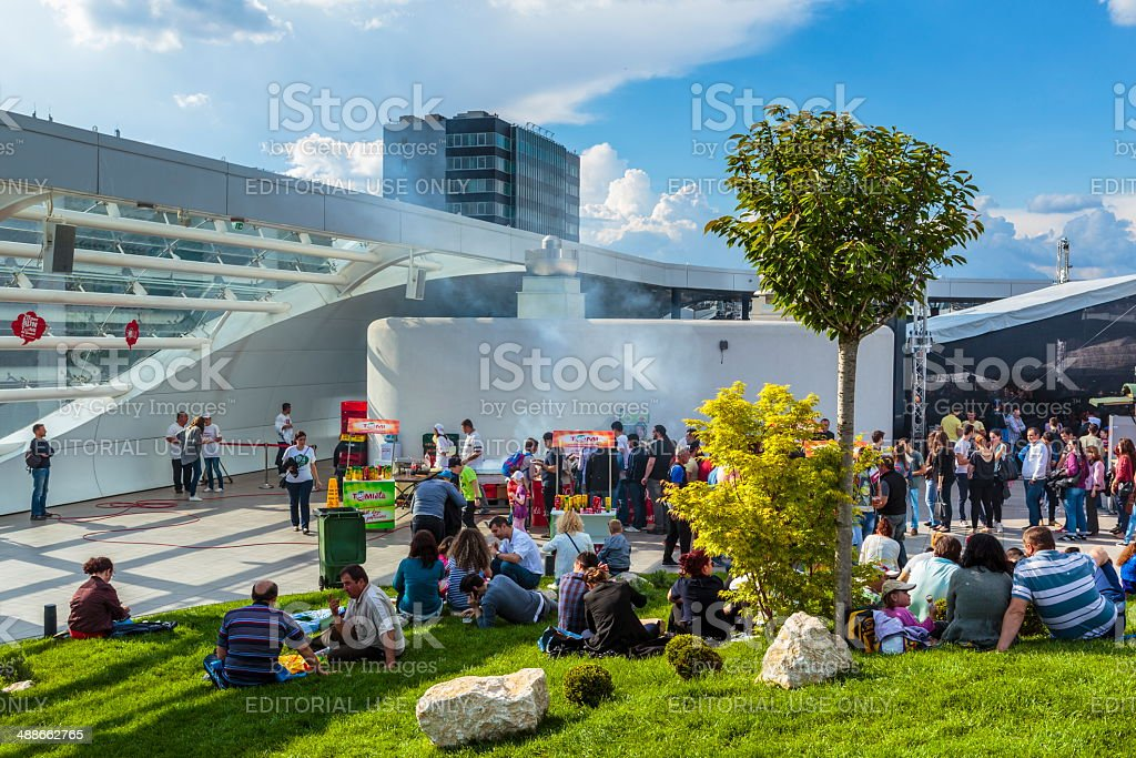People relaxing at mall stock photo