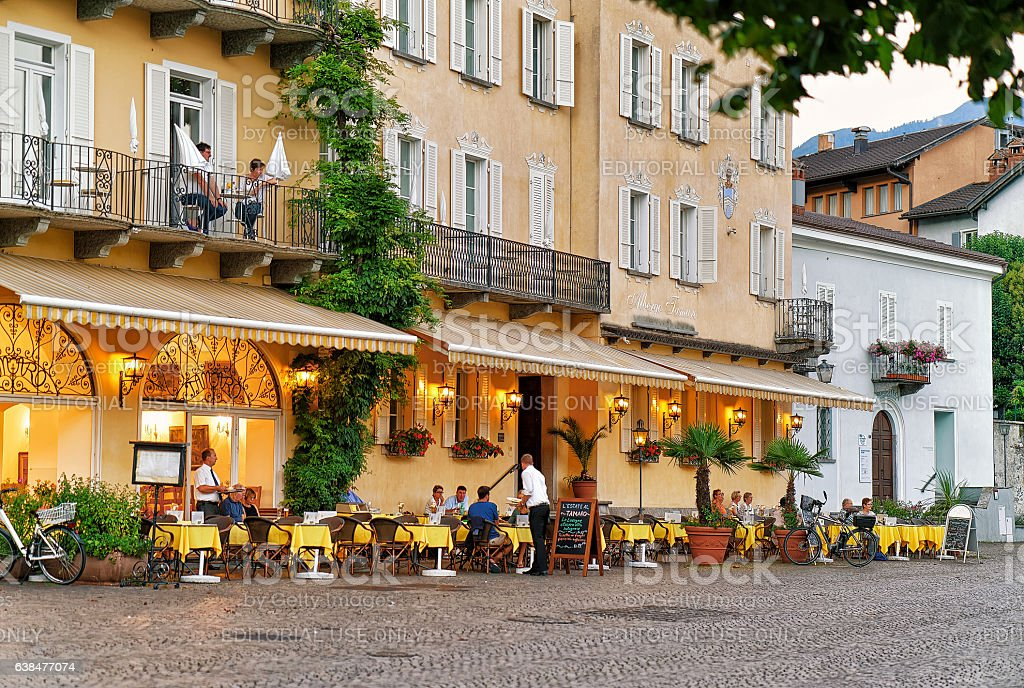 People relaxing at Street Restaurant in Ascona in Swiss stock photo