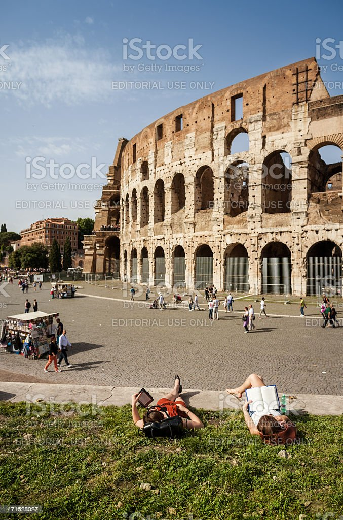 People relaxing by the Coliseum royalty-free stock photo