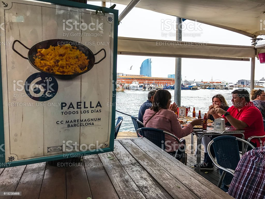 People relaxing in Barcelona restaurant Tapa Tapa, Spain stock photo