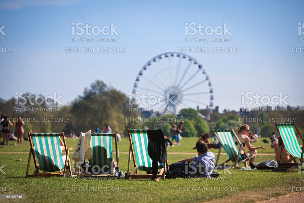 People relaxing in Hyde Park, London stock photo