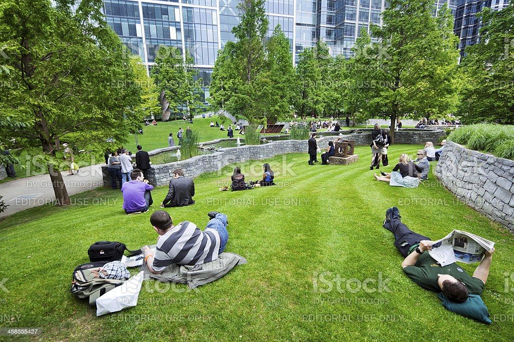 People relaxing in Jubilee Park, London royalty-free stock photo