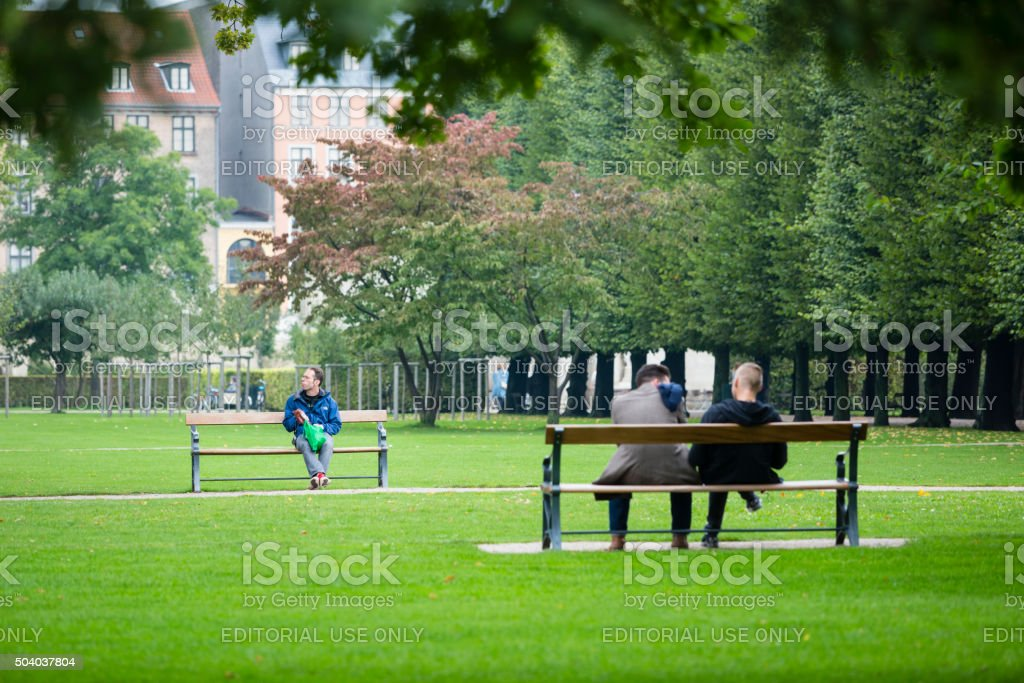 People relaxing in Rosenborg Castle Gardens, Copenhagen stock photo