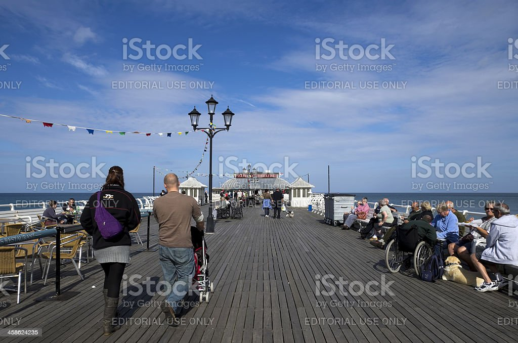 People relaxing on Cromer Pier royalty-free stock photo