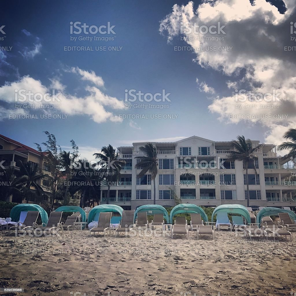 People relaxing on Grace Bay Beach. Turks and Caicos Islands stock photo