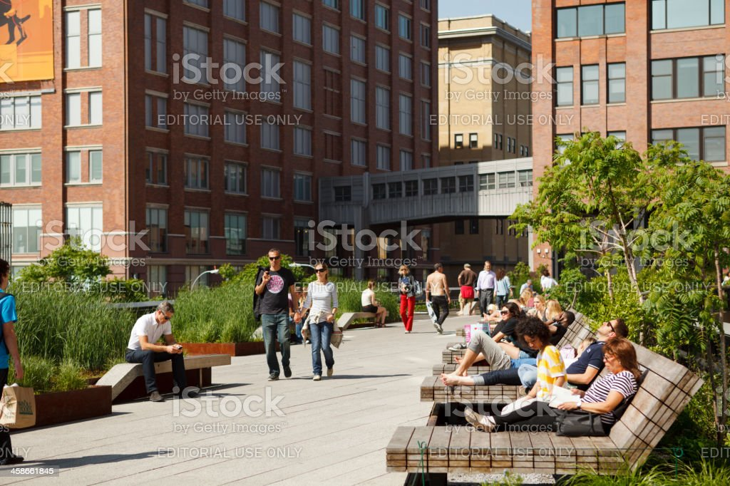 People Relaxing on The High Line New York City stock photo
