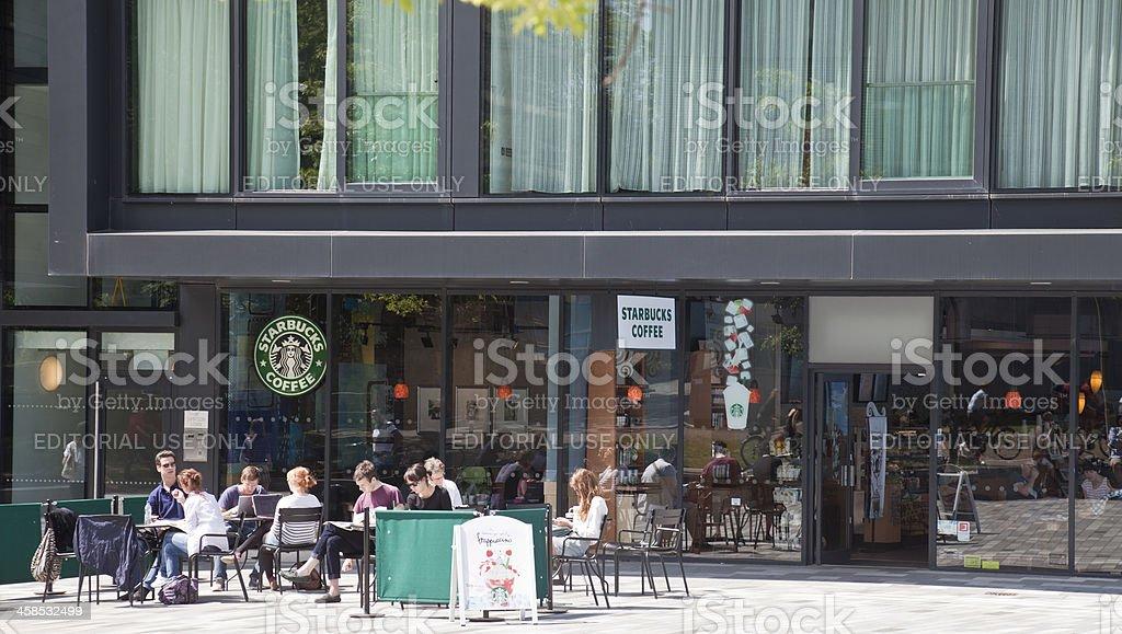 People relaxing outside Starbucks, Edinburgh royalty-free stock photo