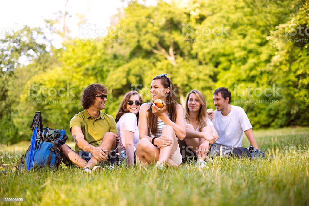 People resting after hiking in nature stock photo