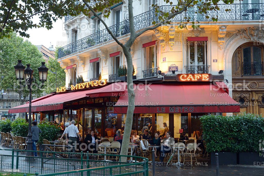 People resting in a street cafe in Paris, France stock photo