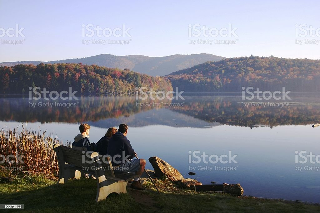 People resting on a bench after a hike stock photo
