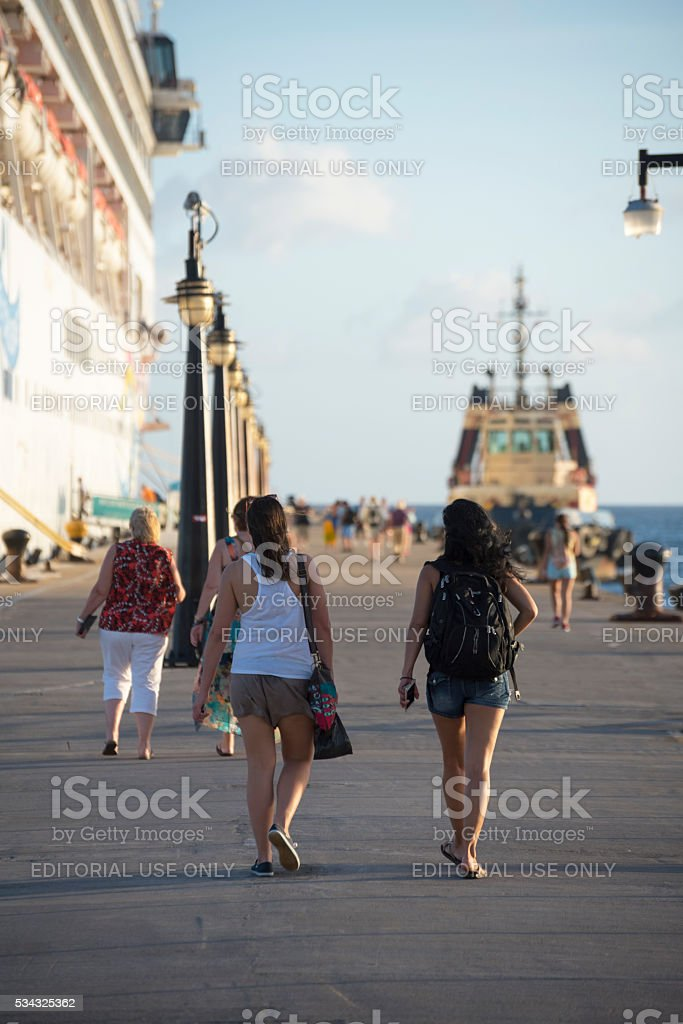 People returning to cruise ship in Saint Kitts stock photo