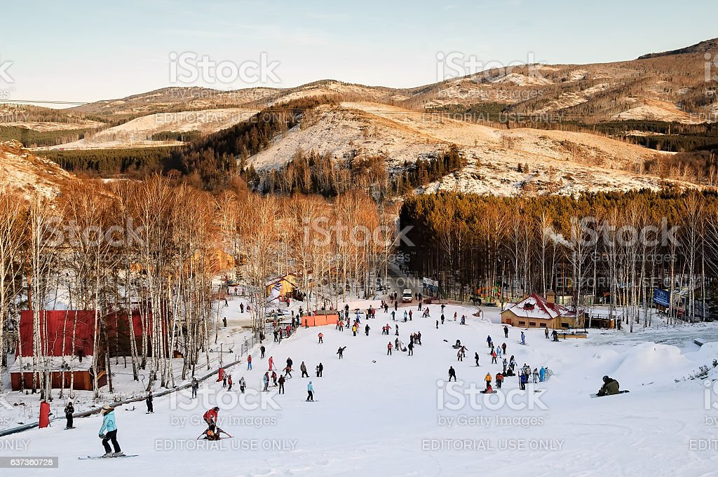 People ride an educational slope stock photo