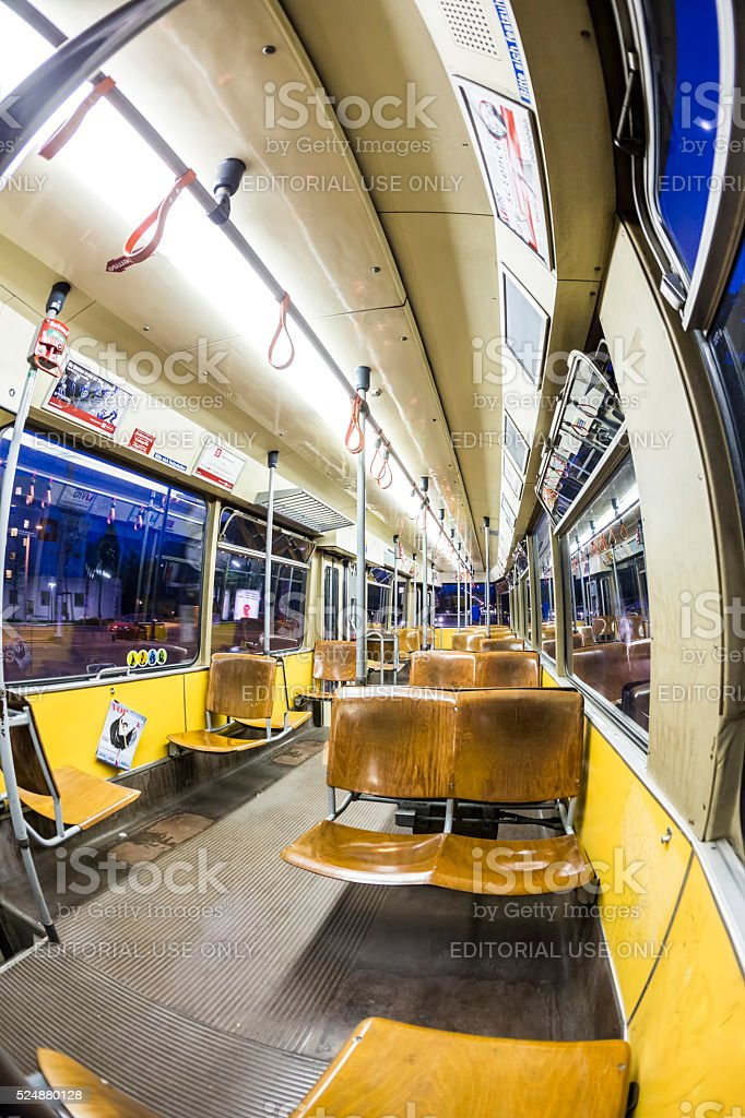 people ride by night on old fashioned tram stock photo