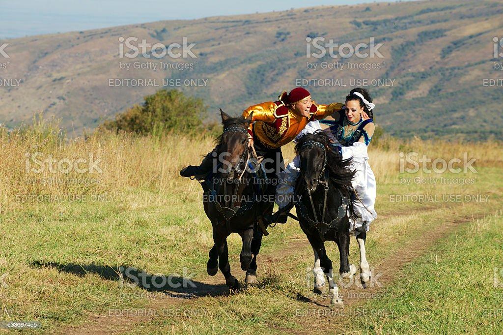 People ride on horseback, Almaty, Kazakhstan. stock photo
