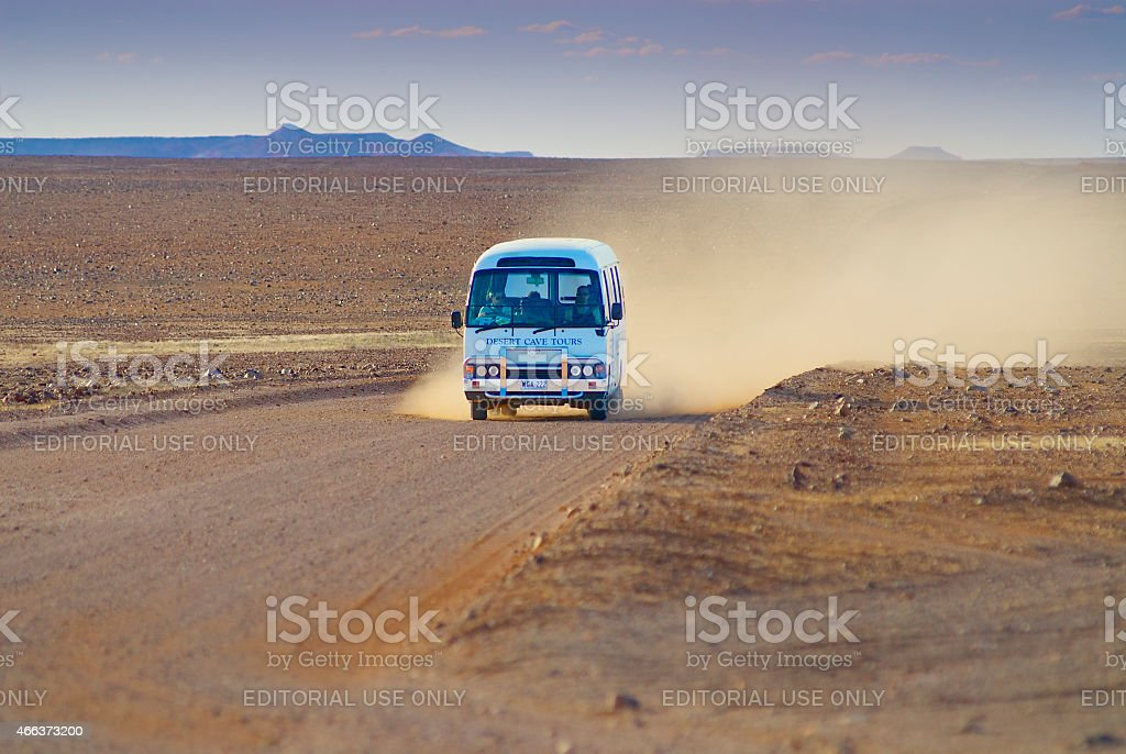People ride tourist bus at Breakaways Reserve, Coober Pedy, Australia. stock photo