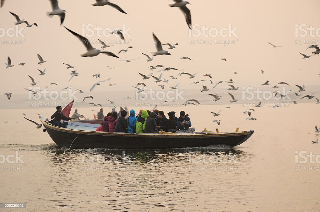People riding boats in the river in Varanasi, India stock photo