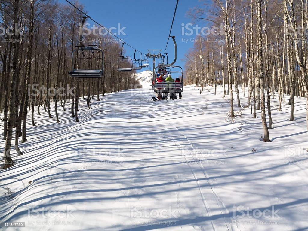 People Riding Chairlift royalty-free stock photo