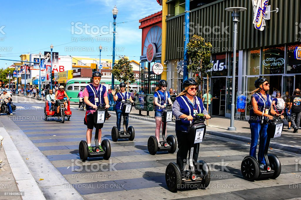 People riding Segway's in Fisherman's Wharf area of San Francisco stock photo