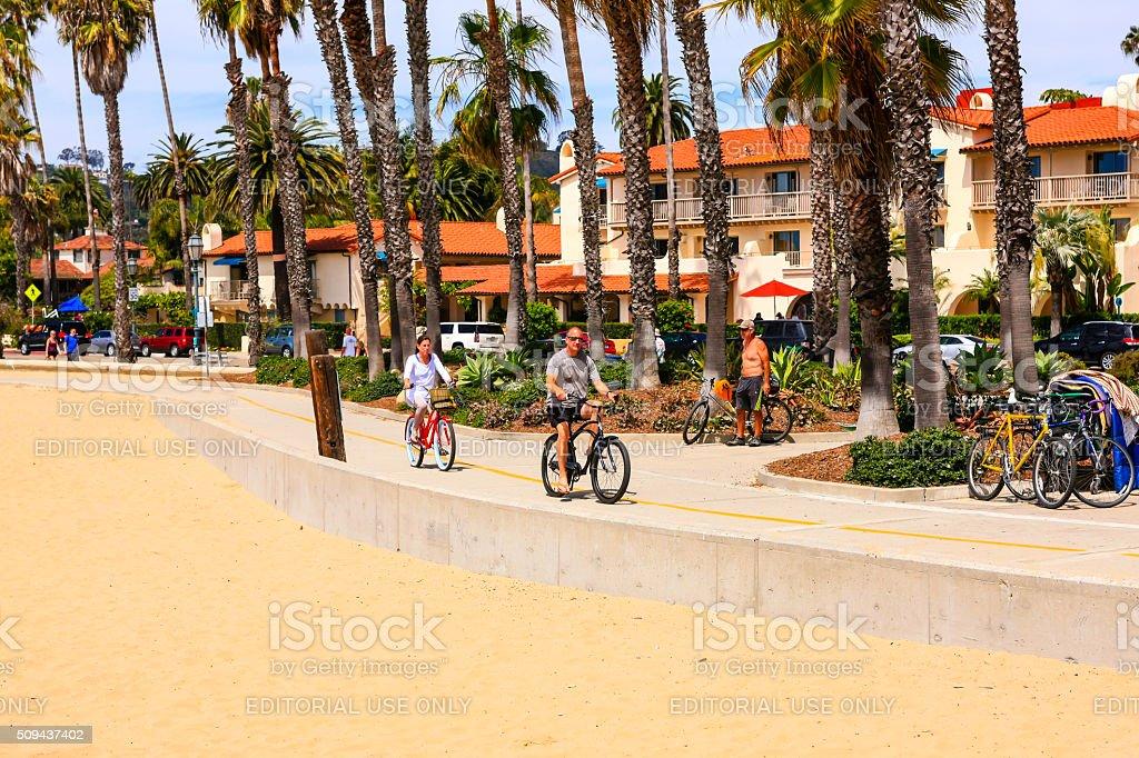 People riding their bicycles along the Santa Barbara bike trail stock photo