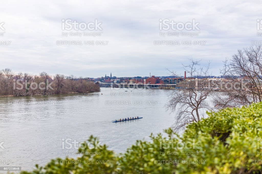 People rowing on Potomac river on many boats with skyline of Georgetown stock photo