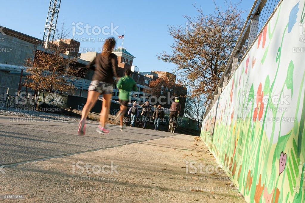 People Run And Bike In Urban Greenspace Along Atlanta Beltline stock photo