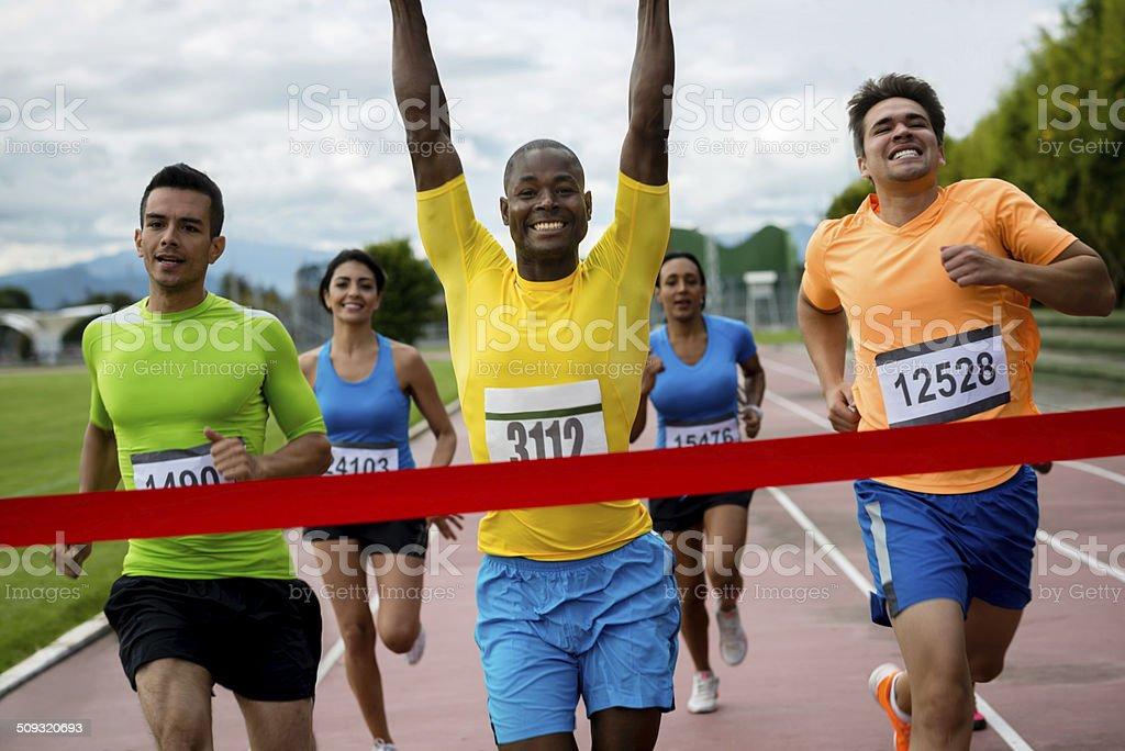 People running a marathon stock photo