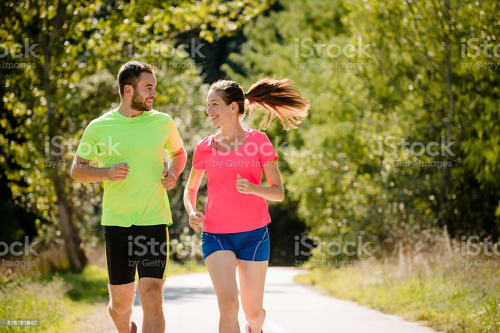 People running and talking together stock photo