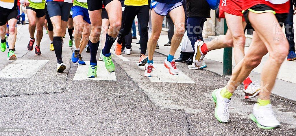 People running in city marathon stock photo
