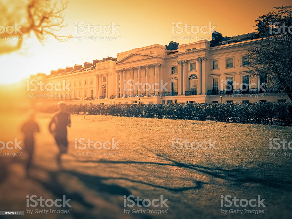 People running in Regent's Park at sunset, London stock photo