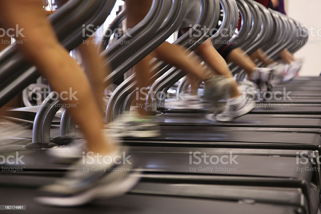 People Running Jogging on Treadmill at Health Club Gym stock photo