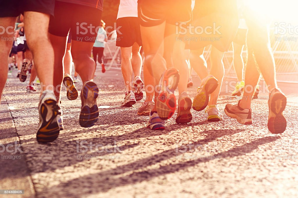 people running marathon stock photo