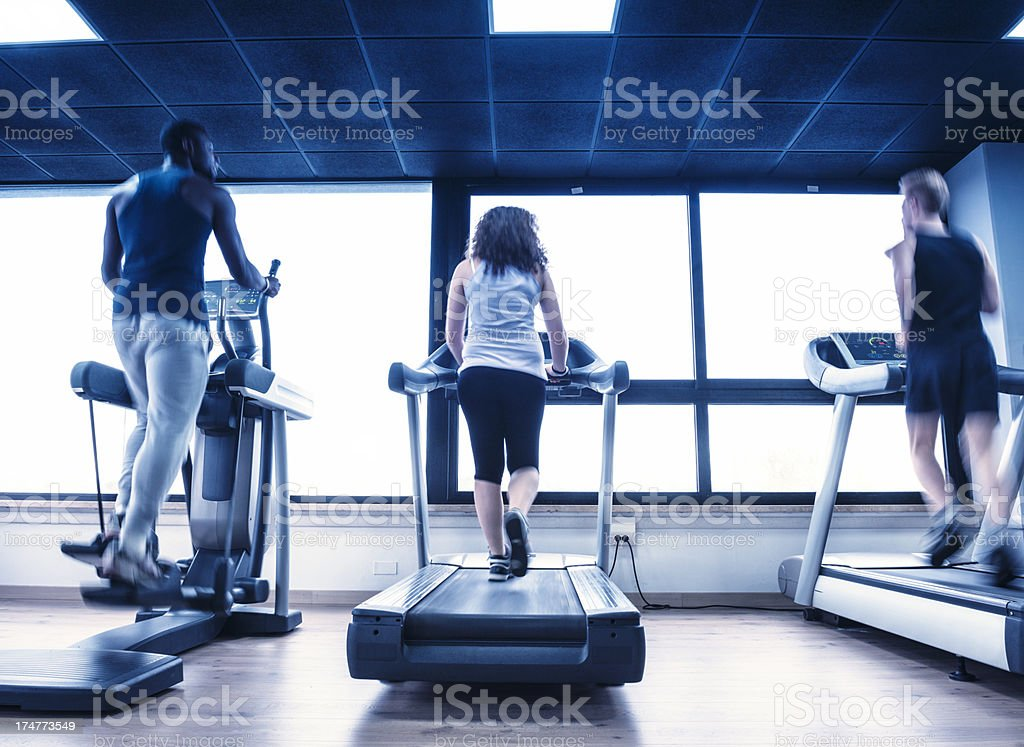 People running on a treadmill royalty-free stock photo