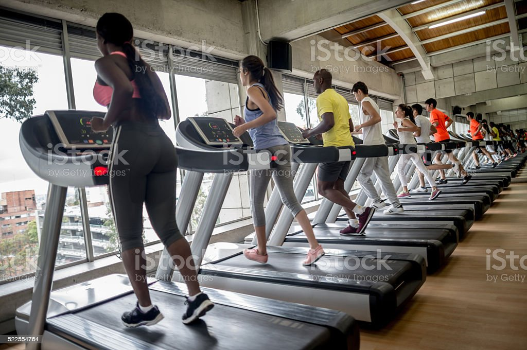 People running on the treadmill at the gym stock photo
