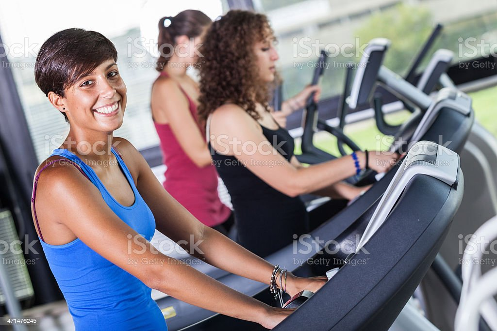 People Running on Treadmill in the Gym royalty-free stock photo
