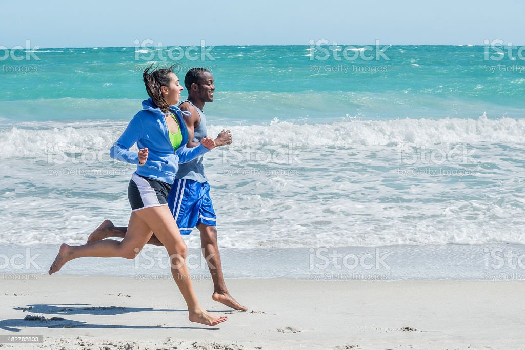 People Running on Vero Beach stock photo