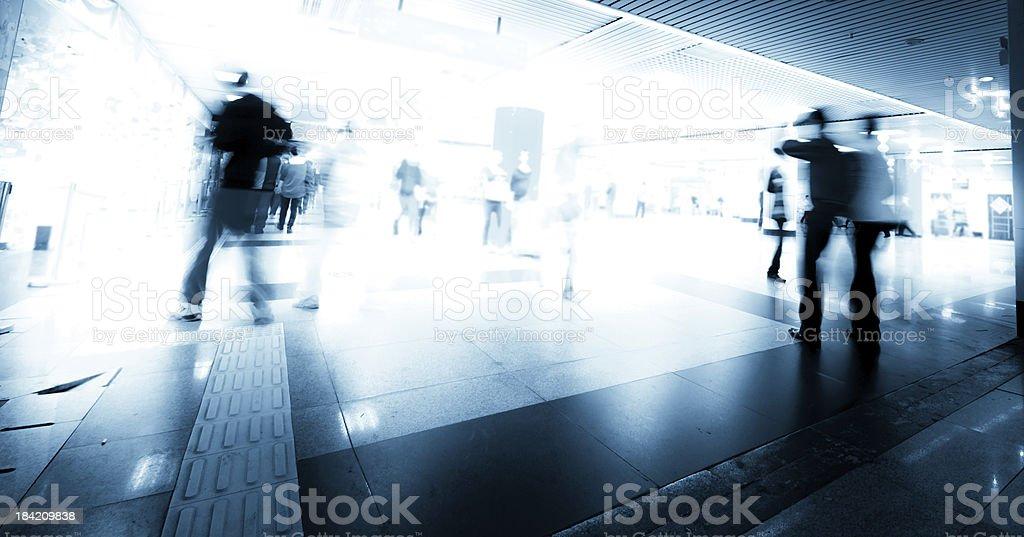 people rush on urban shopping center blur motion royalty-free stock photo