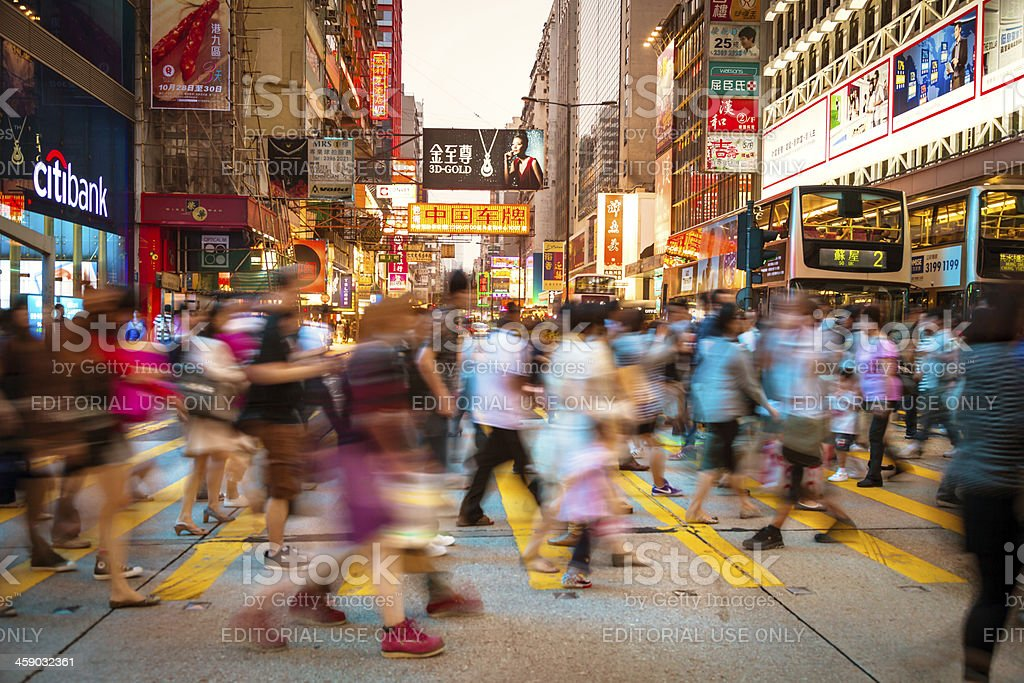 People rushing on a street in Hong Kong, China stock photo