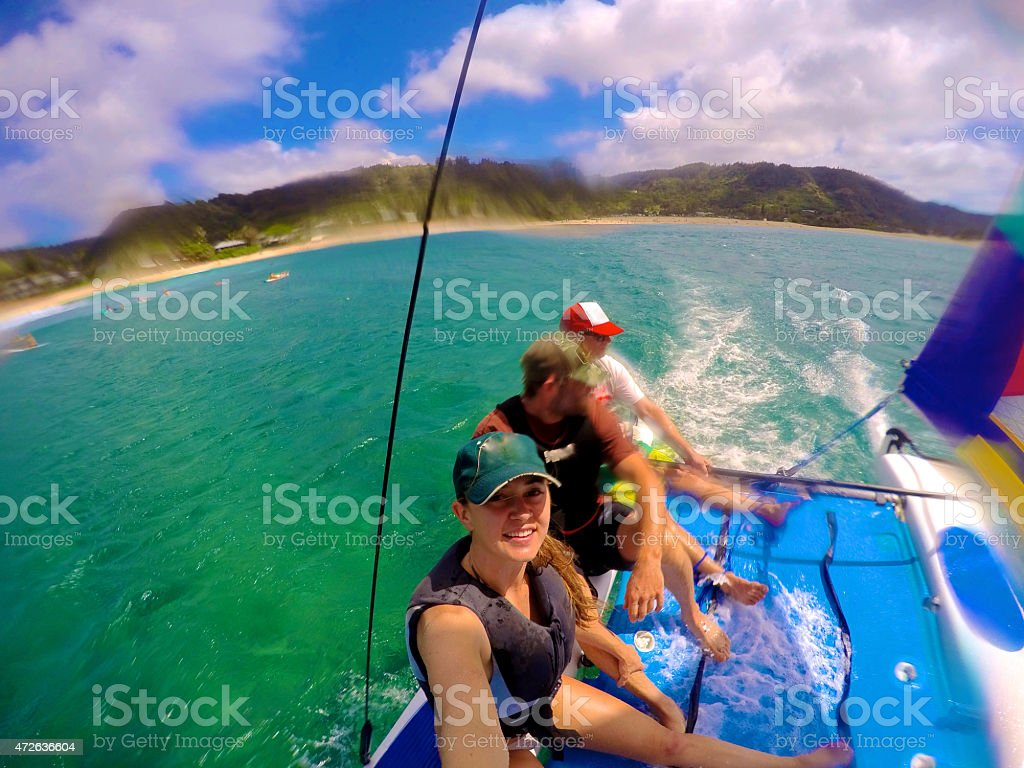 3 People Sailing in a Hobbie Cat in Hawaii stock photo