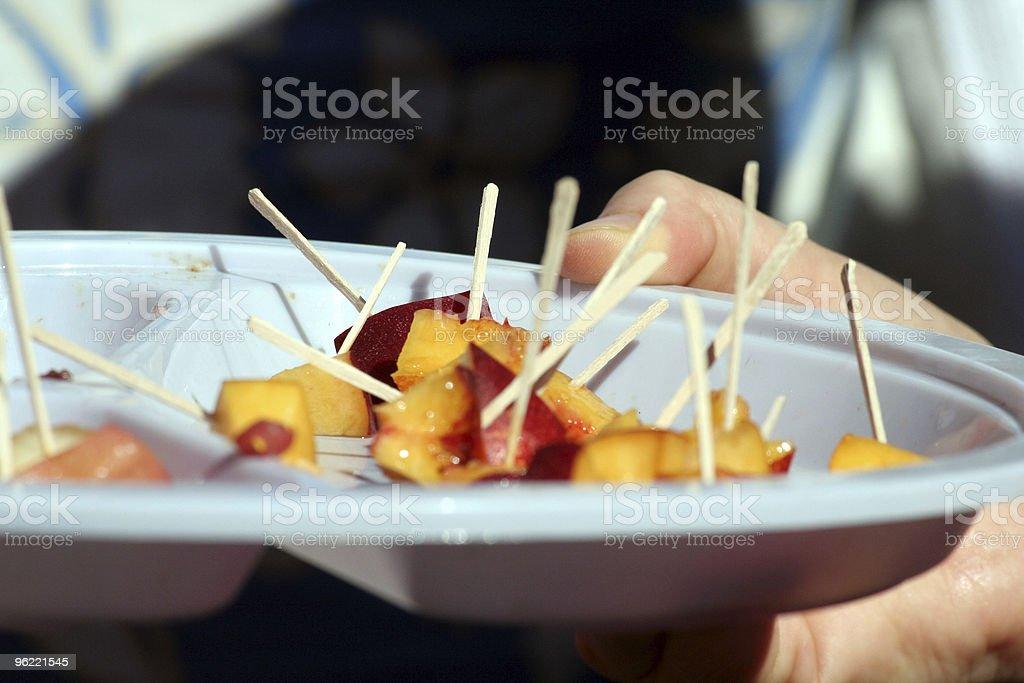 people sampling peach stock photo