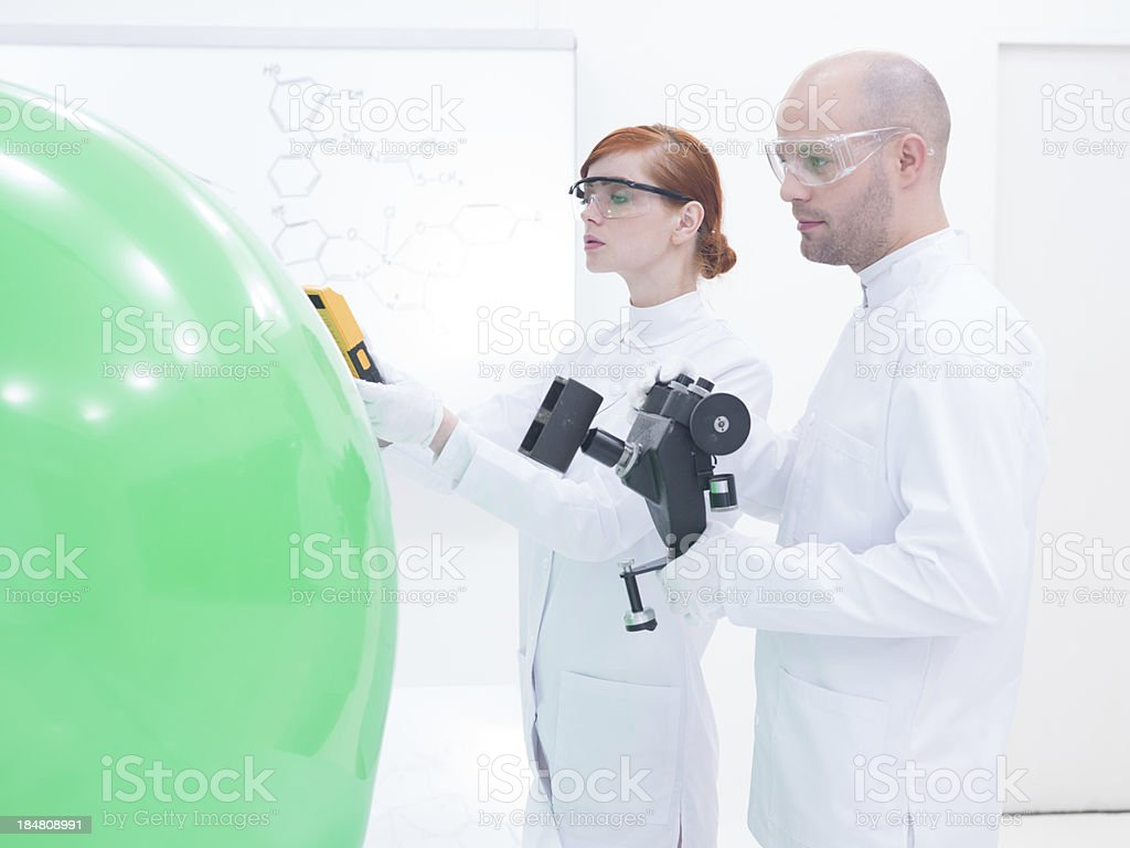 people scanning objects in lab stock photo