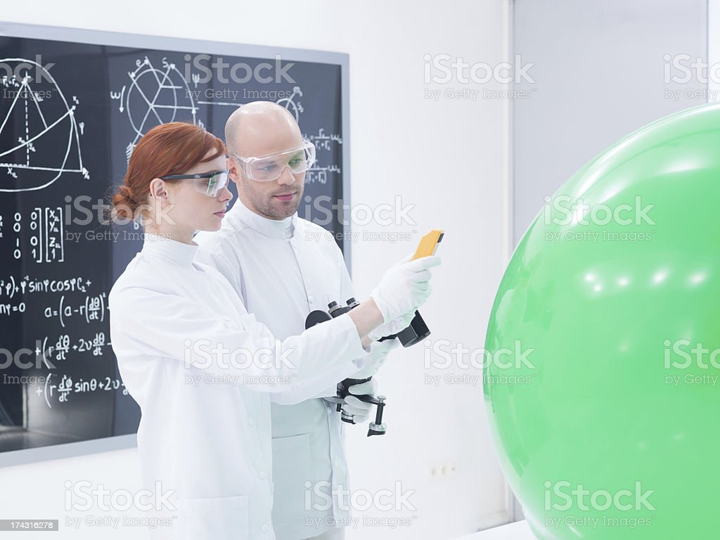 people scanning objects in laboratory royalty-free stock photo