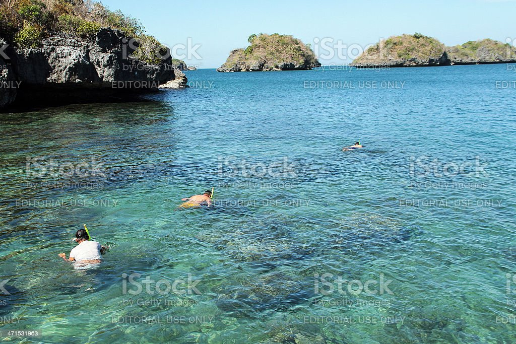 People Scuba Diving/ Swimming in the Sea, Philippines royalty-free stock photo