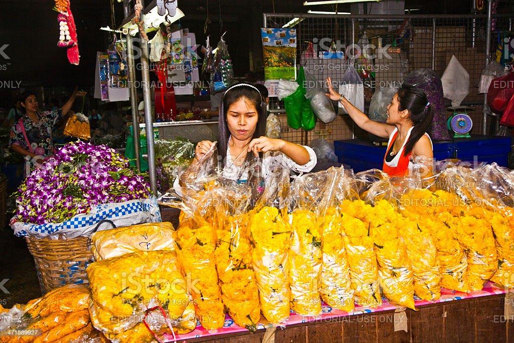 people sell flowers at Pak Khlong Thalat market royalty-free stock photo