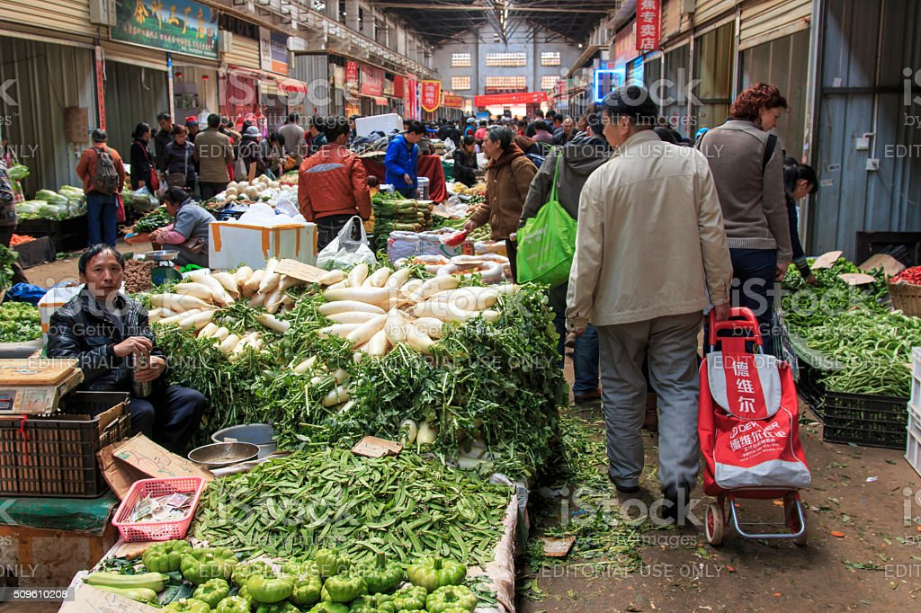 People selling and buying in a market in Kunming stock photo