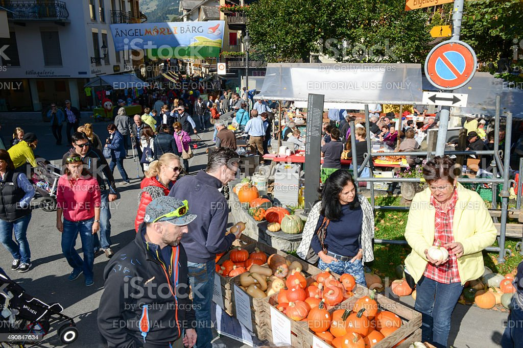 People selling and buying pumpkins at the market in Engelberg stock photo