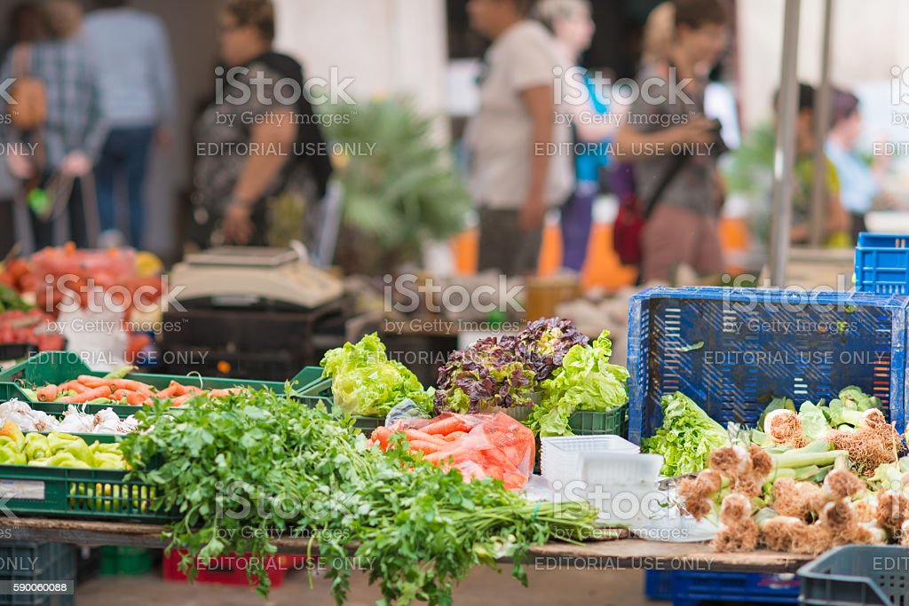 People selling and shopping at city market in Sineu Mallorca stock photo