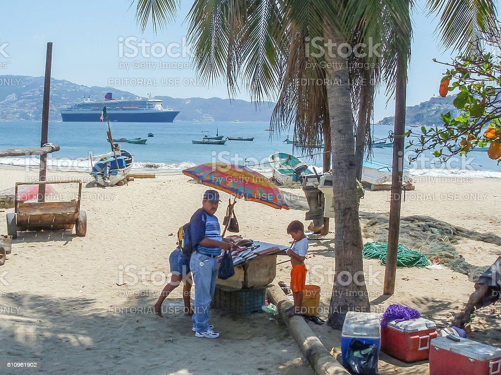 People selling fish on beach stock photo