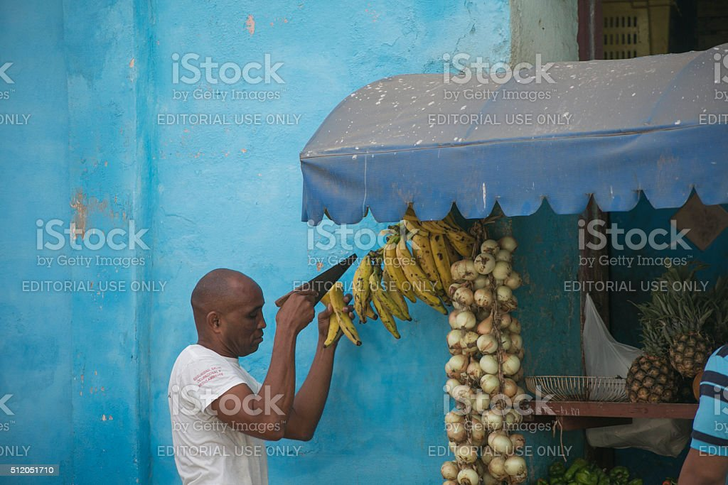people selling fruit  at grocery store in trinidad cuba stock photo